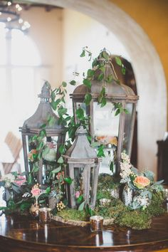 Vintage Lantern Display With Moss and Flowers-love the use of moss and the earthy feel to this...perhaps for card table or placecard board..?