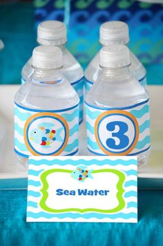 """""""Sea water"""" labels and """"Fish food"""" favors; Love the welcome sign, """"It's good to SEA you!"""""""