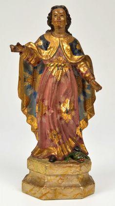 SANTA MARTA - Escultura do imaginário brasileiro esculpida em madeira, ricamente policromada e esgravitada em ouro. Brasil. Século XIX. 23 cm. Base r$2.000,00. Jun16