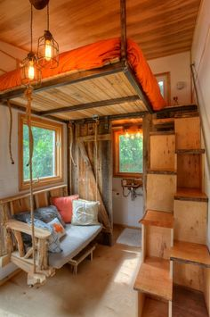 "This tiny house, ""Austin,"" is built on a single axle 12′ trailer. That hanging bed is pretty nifty. To find the article, search on ""Austin"" on the website. 