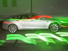 Tesla unveils exotic features, go-fast model