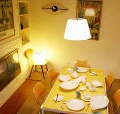 yellow table, white dishes