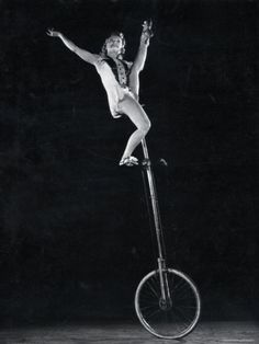 VELOCIPEDE~Hanny Shyretto on a tall unicycle. Photo by Gjon Mili.