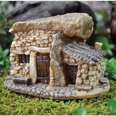 Thatched house,this would make a great fairy house for the garden! Description from pinterest.com. I searched for this on bing.com/images