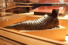 Sabaton with  long pointed  toe in imitation of the  winklepicker boots fashionable  among the medieval nobility.
