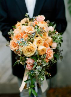 @Mandy Willis Fall peach bouquet... I love the green acorns..could do it with red and white roses!