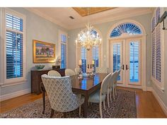 1620 Dolphin Ct, Naples, FL 34102 | Coastal dining room with coral chandelier.  By Ficarra Design.  Royal Harbor in Naples, Florida.