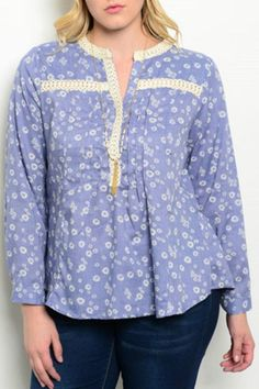 Beautiful plus size top with long sleeves and a white print on a blue base.  Blue Ivory Plus by WAPI Plus. Clothing - Tops - Blouses & Shirts Clothing - Tops - Long Sleeve Wisconsin