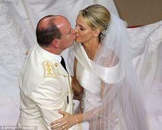 Prince Albert II of Monaco kisses Princess Charlene of Monaco during their lavish wedding at the Main Courtyard of the Prince's Palace.