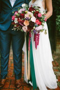Romantic jewel toned dahlia wedding bouquet: http://www.stylemepretty.com/little-black-book-blog/2015/12/09/touch-of-boho-jewel-toned-wedding-inspiration/   Photography: Brianna Wilbur - http://briannawilbur.com/