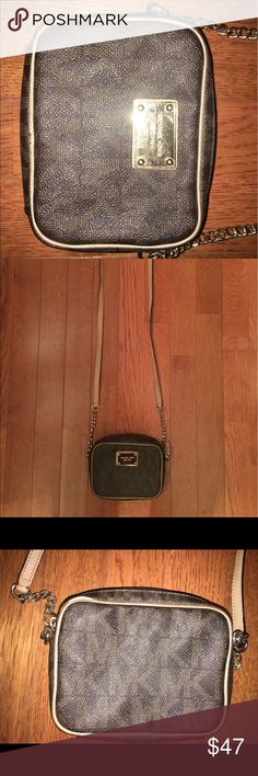 Michael Kors Cross Body purse This brown Michael Kors purse has been well loved but I no longer use it. It is a tan strap with a small black mark on it and gold chains. There is a small rip as shown in the picture on the back of the purse. The inside is tan and can hold small items such as car keys and phone and has a pocket for credit cards. The gold plate is also scratched. Michael Kors Bags Crossbody Bags