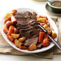 """Dutch oven pot roast recipes are the ultimate comfort food. When juicy pot roast simmers in garlic, onions and veggies, everyone comes running to ask, """"When can we eat?"""" The answer? Just wait—it will be worth it. —Taste of Home Test Kitchen Best Beef Recipes, Pot Roast Recipes, Copycat Recipes, Dinner Recipes, Game Recipes, Favorite Recipes, Oven Recipes, Carne Asada, Beef Dishes"""