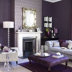Monochromatic || The cool violet color gives the room an intimate, regal feel. With the several patterns around the room (mirror, wallpaper, and sofa) the room also becomes feminine.