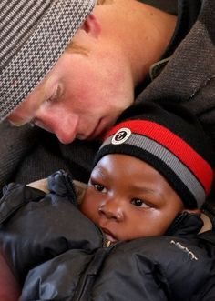 Prince Harry showing Love and Compassion.....