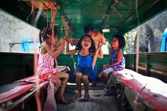 A group of children joyously laughing inside a Jeepney in Cebu City, Philippines. (Photographer: Mac Kwan)