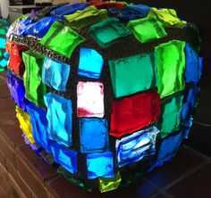 Chunk Glass Lamp - The Cube- 12 inch square. This beautiful illuminated sculpture is hand made by California artist Troy Boepple. The glass chunks are individually cut from 12 inch by 8 inch by 1 inch thick slabs of glass also know as Dalle de Verre. The glass slabs used in these creations are from an art glass manufacturer that has been in business since 1898 and was one of the original suppliers for Tiffany's. Each of the glass chunks are hand chiseled.