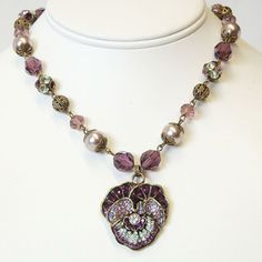 @Overstock - This sculptured pansy necklace is jeweled with pave-set Swarovski crystal. Each of the three petals is formed to appear delicate.http://www.overstock.com/Jewelry-Watches/Sweet-Romance-Jeweled-Pansy-Flower-and-Pearls-Necklace/4747093/product.html?CID=214117 $54.99