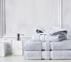 Gray and white bathroom accessories, bath towels, soap dispenser and tissue cover. Must haves for any bathroom design. Gray And White Bathroom, White Bathroom Accessories, Grey And White, Bathroom Cabinetry, Contemporary Bathroom Designs, Classic Bathroom, Waterworks, Luxury Bath, Bath Rugs