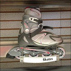 Wire dividers make a runner for the inline wheels of this Rollerblade Skate Hook for Slatwall. Slat Wall, Skates, Golf Bags, Chalkboard Walls