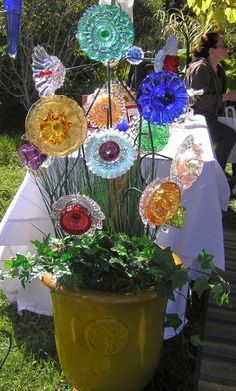 Thrift store glass plates into garden flowers....