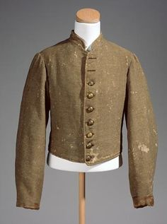 The butternut jacket of William A. Branch, Company G, 57th North Carolina Infantry, embodies the typical Confederate shell jacket or roundabout in color and cut.