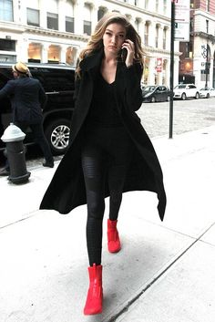 Gigi Hadid wearing Alo Yoga Athena Moto Leggings, Puma by Rihanna Fenty Trainers in Red and Vianel Saffron Iphone Case