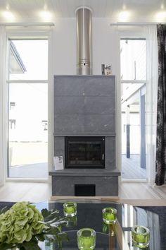 Tulikivi fireplace http://www.asuntomessut.fi/sites/default/files/imagecache/content/kokkola2011-39-moderna-takka.jpg