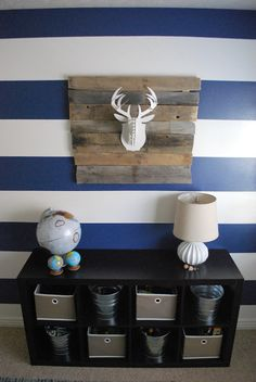 Faux deer head - place on rustic wood.