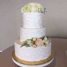3 Tier cake with a rustic looking sideways spatula design and some soft colored fresh flowers makes this cake perfect for a garden wedding! This cake serves 95