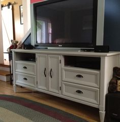Dresser turned TV Stand.  $45 Craigslist dresser, $20 in new hardware, $8 in Primer, reused paint from another project = $73.00 tv/entertainment stand!