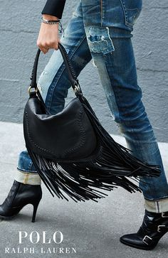 The perfect fringe handbag: spacious enough for all of your daily necessities, this supple-leather saddle bag has a top handle and fold-over flap with intricate whipstitching and layers of swingy bohemian-inspired fringe.