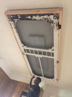 Using an old screen door to cover the florescent lighting! Alternative to a wooden framed box! - Dumpster Diva