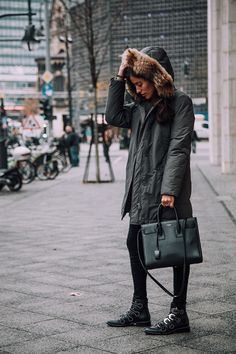 Fur trimmed parkas are ideal for winter, we suggest investing in one for both style and comfort. Sylvia Haghjoo wears hers with jeans and a cool pair of studded boots. Coat: Woolridge, Jeans: 7 For All Mankind, Shoes: Givenchy, Bag: Saint Laurent.