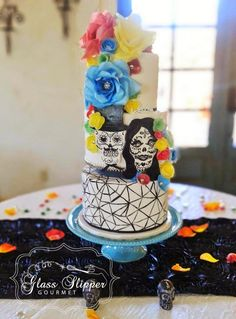 Day of The Dead themed wedding cake with handpainted sugar skull plaque, waferpaper roses and sugar lace by Glass Slipper Gourmet #sugarskullweddingcake #diasdelosmuertosweddingcake #bayareaweddingcakes