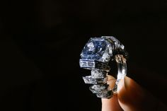 """""""The Sky Blue Diamond,"""" a blue diamond ring created by Cartier, during a press preview by Sotheby's Auction House in Geneva. """"The Sky Blue Diamond"""" weighing 8.01 carats was auctioned at a 'Magnificent jewels & noble jewels auction' in Geneva on November 16, 2016 at a price of US 15.9 million euros, the auction house said. FABRICE COFFRINI / AFP."""