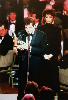 """allmyinstincts: """" Peter Gabriel accepting an award presented by Kate Bush, 1987. """""""