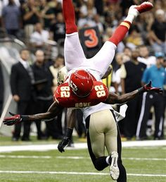 Kansas City Chiefs wide receiver Dwayne Bowe (82) is upended by New Orleans Saints cornerback Patrick Robinson in the first half of an NFL football game in New Orleans, Sunday, Sept. 23, 2012. (AP Photo/Bill Haber)