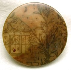 Antique vegetable ivory button with country house painting.