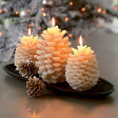 "This winter season, bring the outside in with this nature-inspired Christmas decoration. These holiday candles have a unique pine-cone shape that have been ""frosted"" with a faux snow"