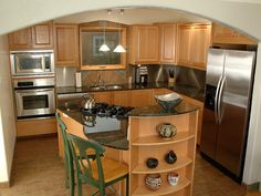 Kitchen Design: 10 Great Floor Plans : Rooms : Home & Garden Television  A lot in small space.  Rounded edges.