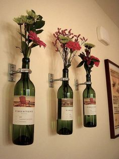 Be Creative with Old Wine Bottles After you drink the wine, what the heck can you do with the wine bottles. Quite a lot, actually. And wine barrels make great DIY project too. Here are some DIY Wine bottle ideas; let us know which project you will try. Wine Bottle Flowers, Wine Bottle Vases, Wine Bottle Crafts, Glass Bottles, Bottle Wall, Empty Bottles, Beer Bottles, Champagne Bottles, Reuse Wine Bottles