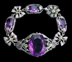 BERNARD INSTONE 1891-1987 Arts & Crafts Bracelet  Silver, amethyst & peridot  Length: 18.5 cm (7.4 in)  Width: 2.7 cm (1 in)  English. Circa 1930 Fitted case. Sold by Tadema Gallery.