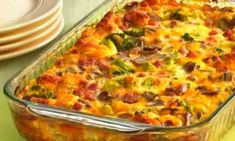 Tasty Recipe Pick: Ham and Cheese Omelet Bake. Here's a brunch bake that has it all, from ham and cheese to veggies, with a biscuit crust. Breakfast Dishes, Breakfast Casserole, Breakfast Recipes, Egg Casserole, Breakfast Bake, Casserole Recipes, Breakfast Crowd, Casserole Ideas, Broccoli Casserole