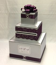 This handcrafted card box/money holder is the perfect touch for  your wedding reception.Beautiful satin fabric covered box in shape of a three  layer wedding cake, decorated with white pearl beads, satin ribbon, silk flowers or ribbon bow on top .  We can personalize your card box with names ,event dates for free  You can choose different colored fabric , ribbon or flowers,but  contact me, please,to discuss the custom preferences, before you place your order !  It usually takes 5-6 weeks...
