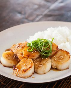 Perfectly seared scallops are simmered in a savory, tangy mustard-miso sauce that pairs perfectly with a side of minute white rice. A tasty, classy meal idea!