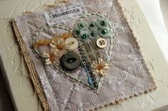 Rebecca Sower stitched heart.  I would love to do this using trims, buttons, zippers, etc. from my bean's clothes.