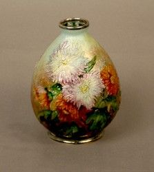 Enamel Vase    A petit floral hand applied enamel over a cooper body vase by Faure.  Made in France                    Circa: 1925  Signature: C. Faure Limonges    Dimensions: 5 1/4 in. H