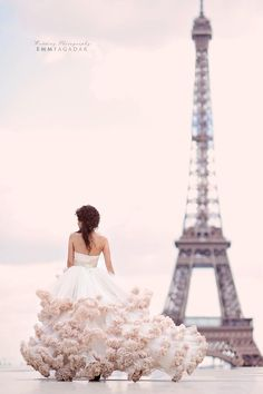 Le Magnifique Ruffle Wedding Gown in front of Eiffel Tower