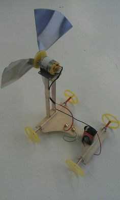 Propellor powered prototype toy vehicle. Aluminum propeller. Powered by 9V battery. Bamboo axles with laser cut wheels. Turbine mount ply, glued with glue gun.