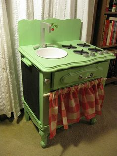 Vintage Looking Play Kitchen by Jane Little. Jane donates all her proceeds for these little kitchens to a homeless lunch program! What a great idea.